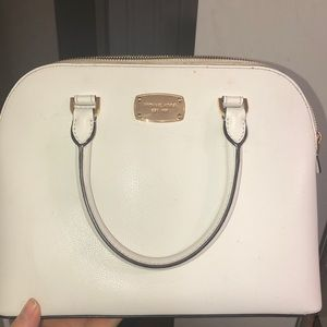 Micheal kores white hand bag